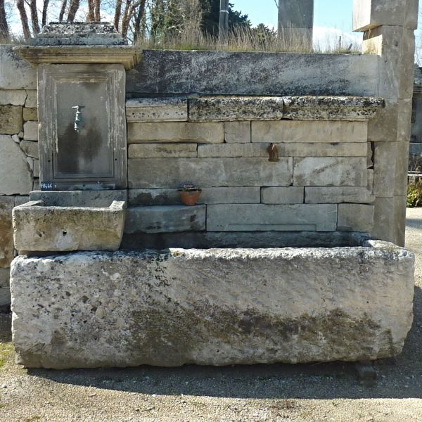 Large wall fountain in stone | Garden fountain with antique stone trough | One of the kind fountain for sale in Provence at BIDAL Antique Materials.