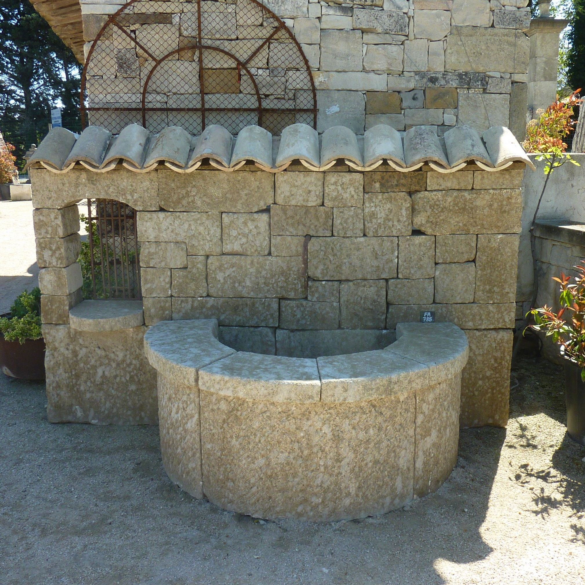 Large wall fountain in stone | A unique model of stone fountain for sale in Provence at BIDAL.