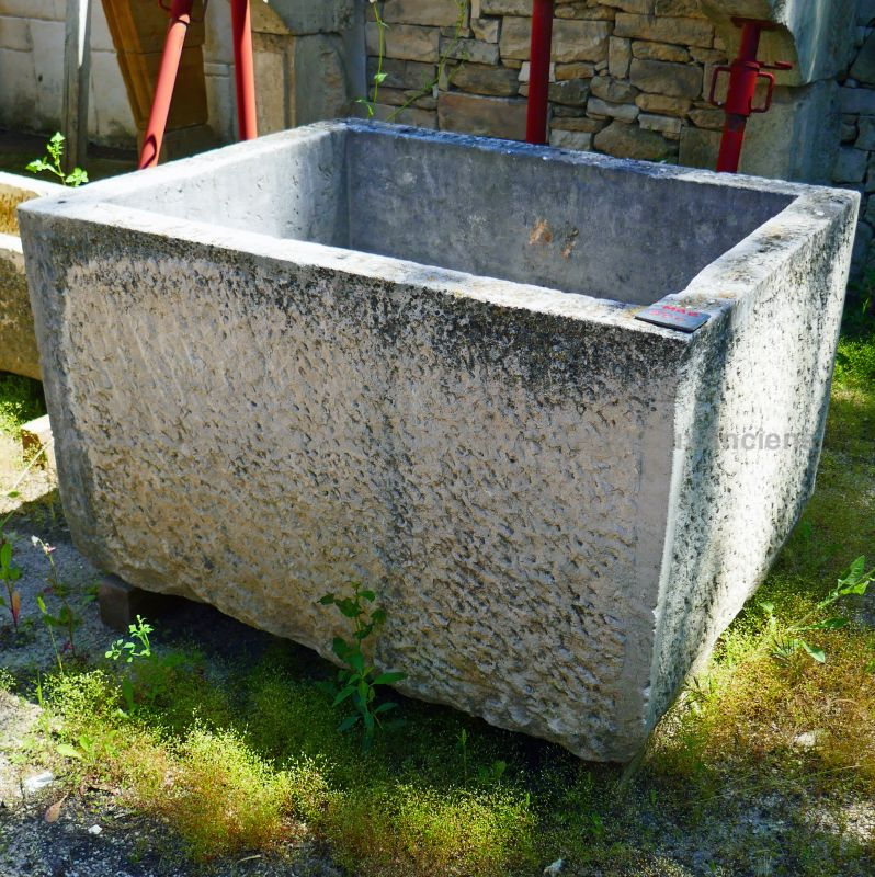 Old stone trough for sale at Alain Bidal Antique Materials in Provence