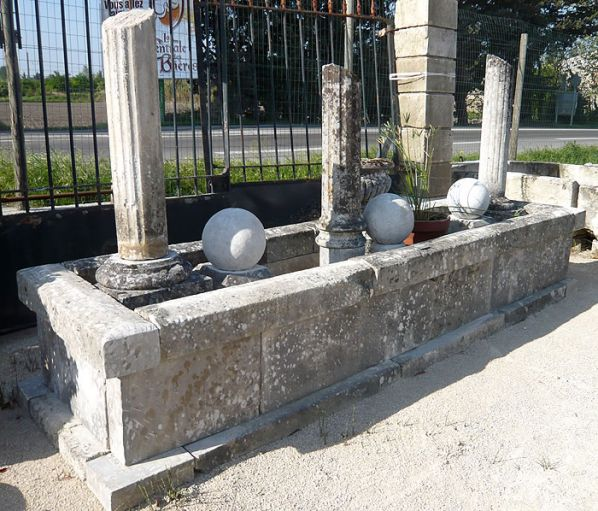Beautiful stone garden with pediment that can be transformed into outdoor fountain with basin.