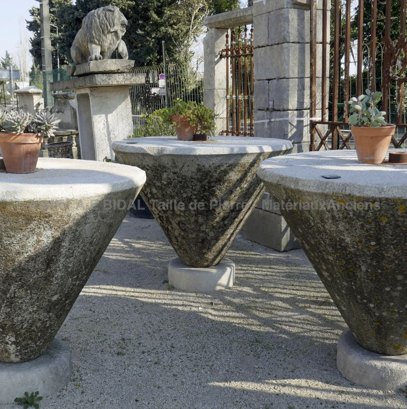 Massive high round table in patined granite stone