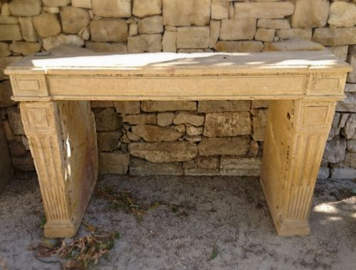 Antique French fireplace in stone - A Louis 16 stone fireplace.