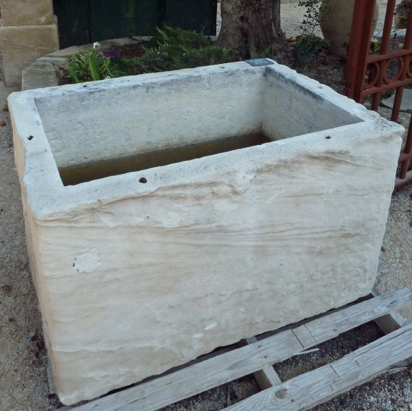 Stone basin with a rustic look that could make a very pretty flower pot or stone planter.