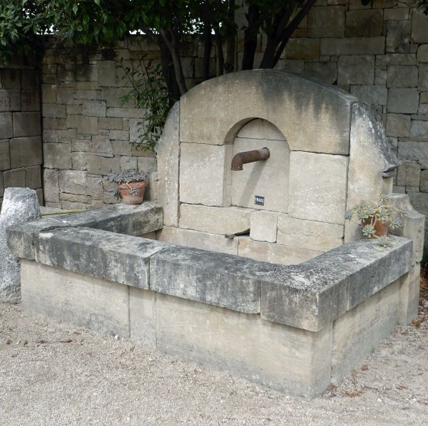 Beautiful large stone fountain with water outlet iron - wall fountain.