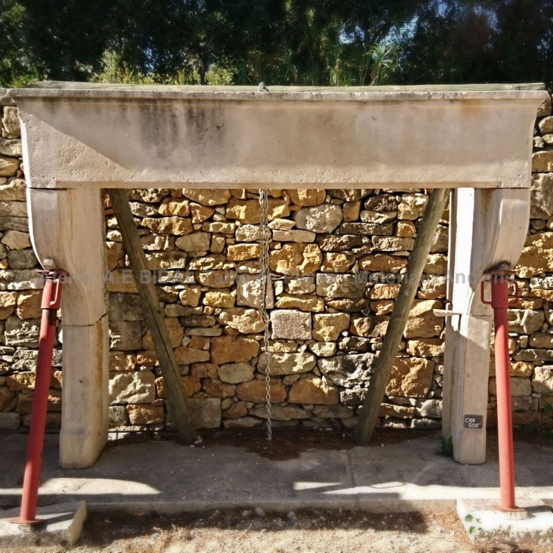 Large old fireplace - 17th century rustic fireplace in light colored stone.