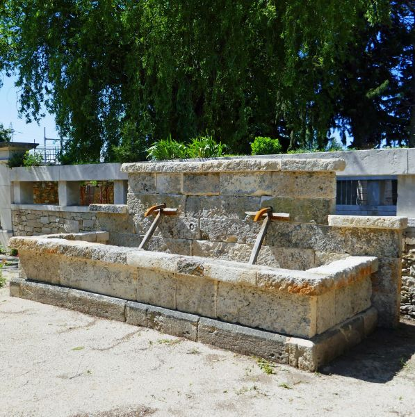 Large wall fountain made of reclaimed stones : antique garden fountain in stone by Alain BIDAL Antique Materials in Provence.