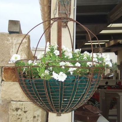 Handcrafted wrought iron planter - decorative objects made of old materials.