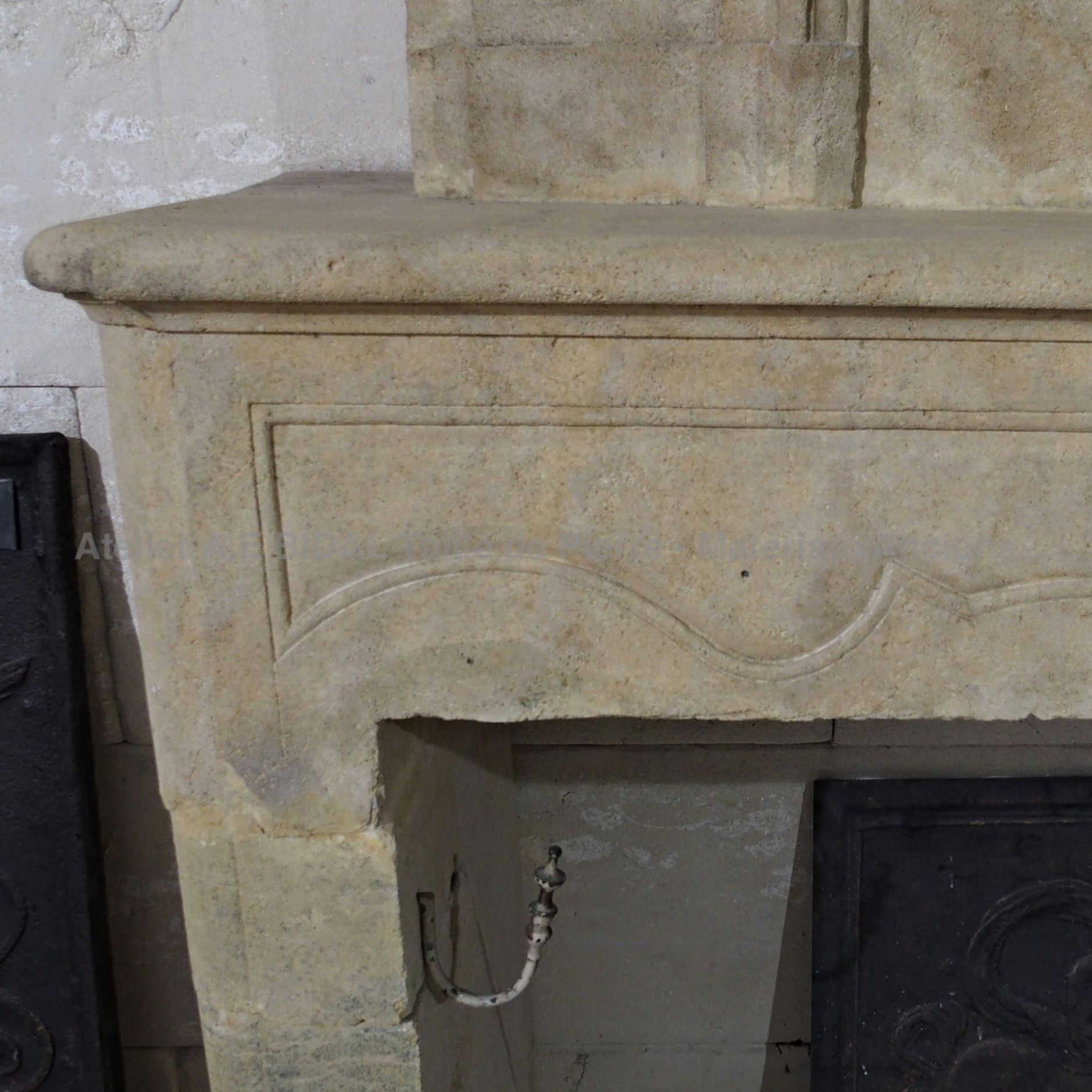 fireplace with overmantle: an old fireplace whose rather simple decor gives it a nice depth.