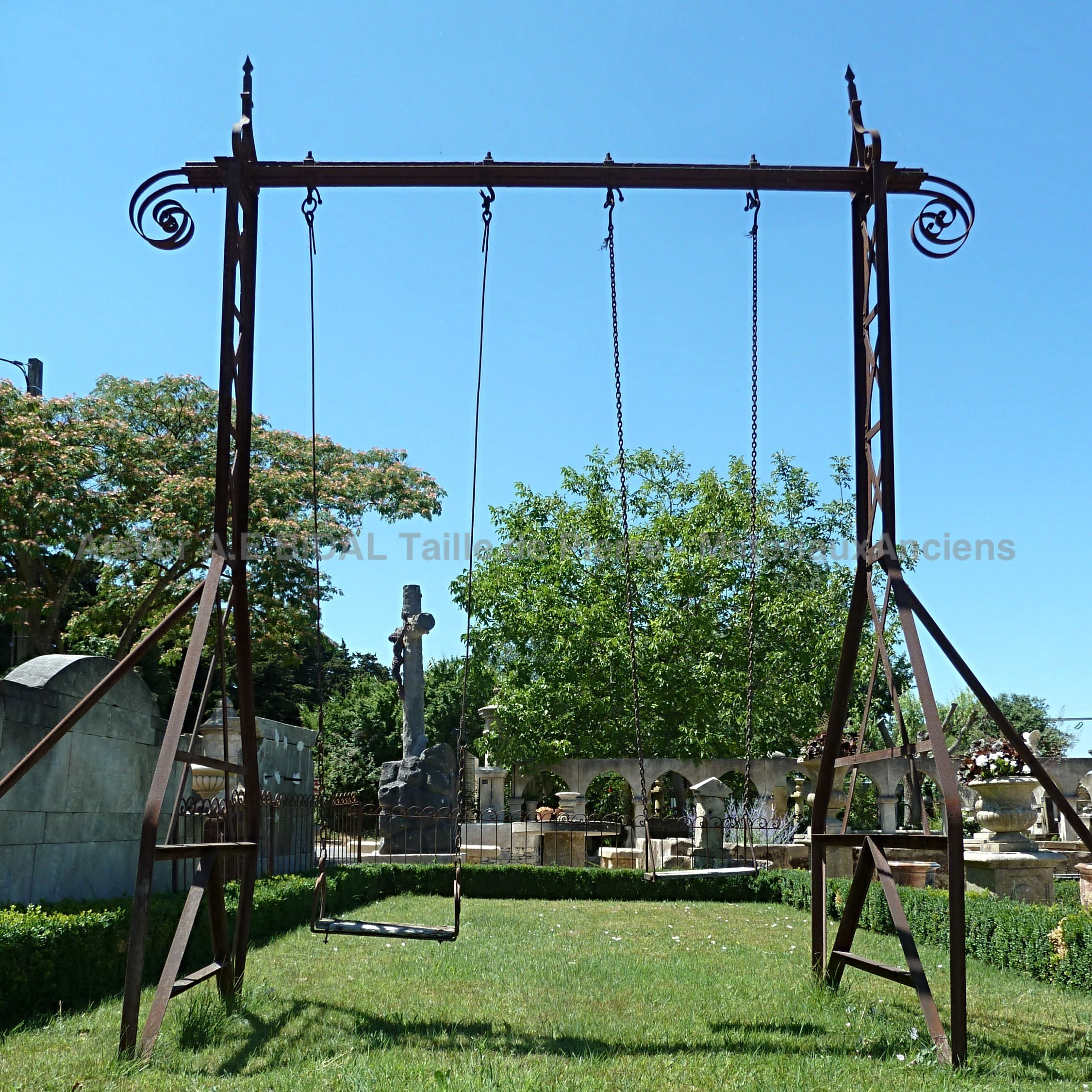 Wrought iron swing - garden games made of old materials.