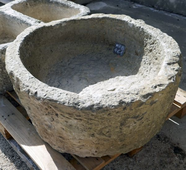 Large antique circular shallow stone trough for sale at Alain BIDAL Antique Materials in Provence.