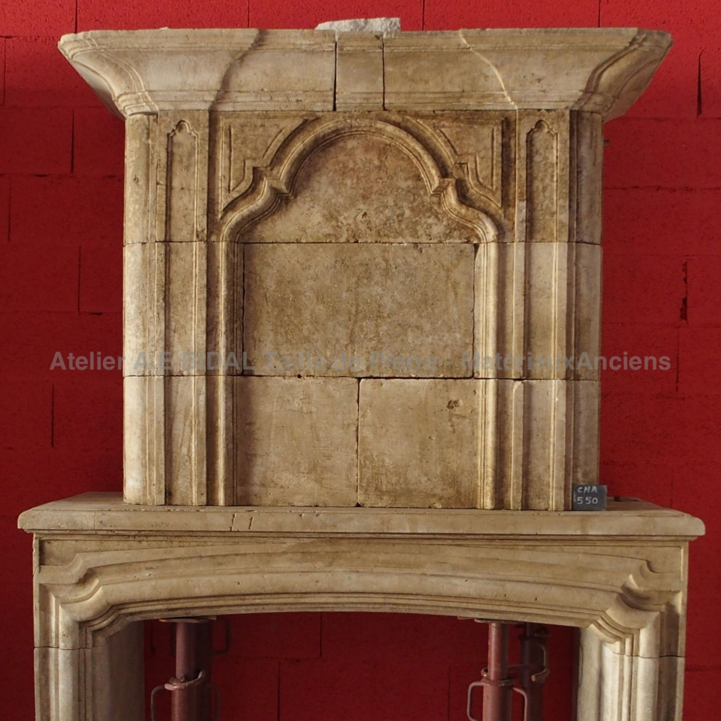 Antique stone fireplace  - a traditional, robust and elegant fireplace.