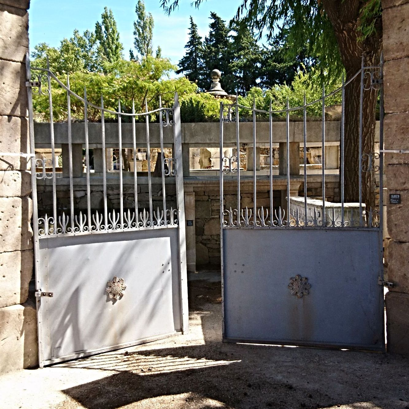 Elegant French driveway gates in riveted wrought iron