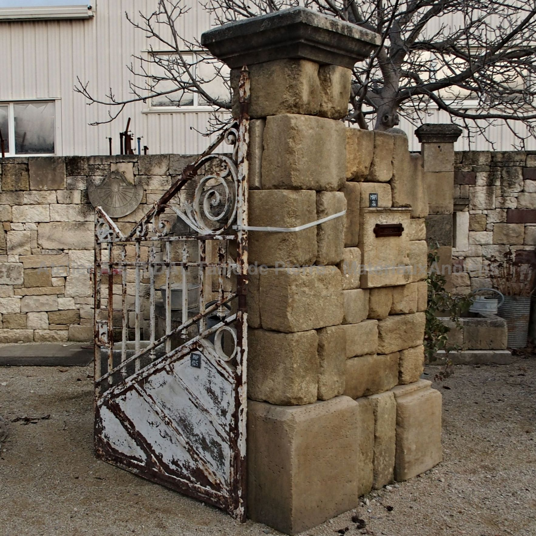 Wonderful antique wrought iron gates with a white color and a beautiful patina