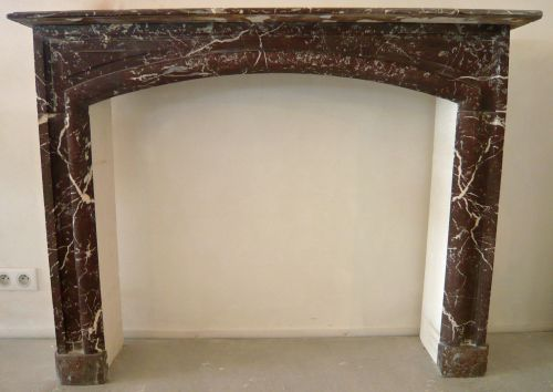 Antique red marble mantle for sale at Alain Bidal Antique Materials in provence.