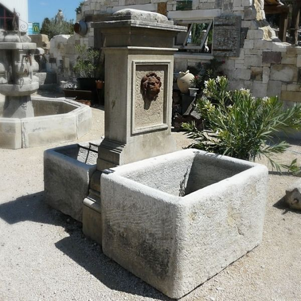 Central fountain in a whitish natural stone | Decorative fountain in aged natural stones.