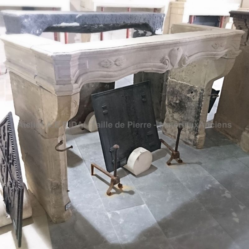 Antique fireplace in real stone - fireplace formerly sponsored for an engagement.