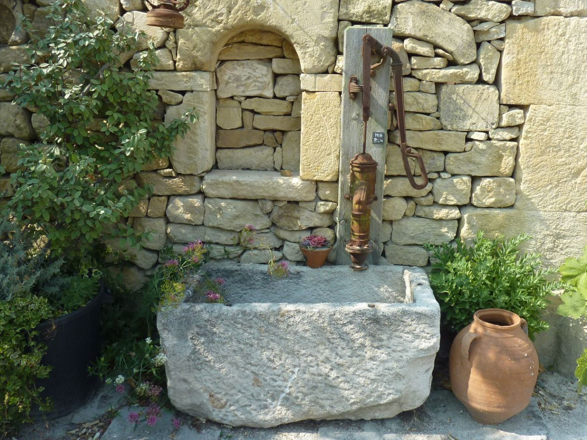 Fountains with antique manual water pumps