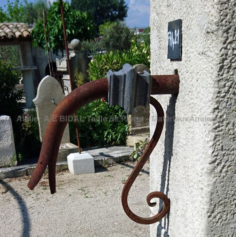 "Detail of the water outlet ""duckbill"" wrought iron on our wall fountain in old stones - Atelier Alain BIDAL."