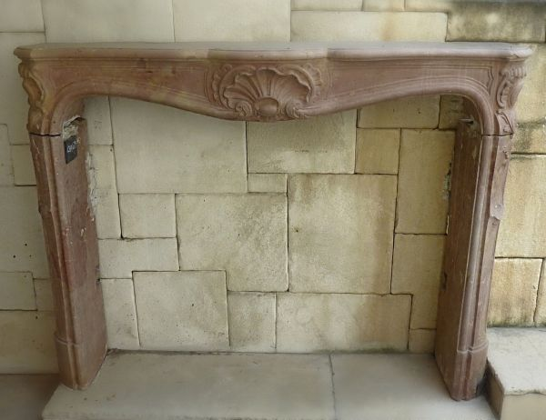 Antique stone fireplace - A pink stone mantle.