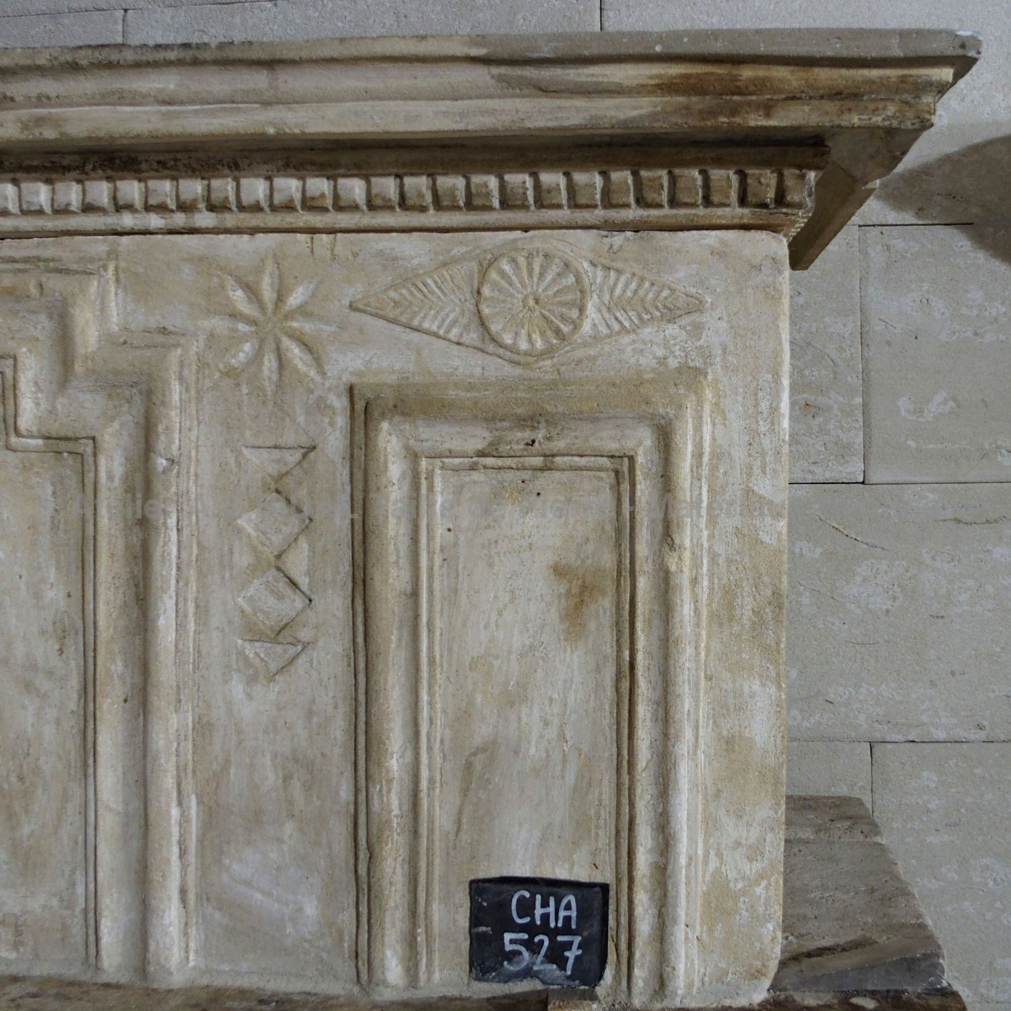 fireplace with overmantle - a Louis 16 fireplace which partially resembles the style of a Louis 13 fireplace.