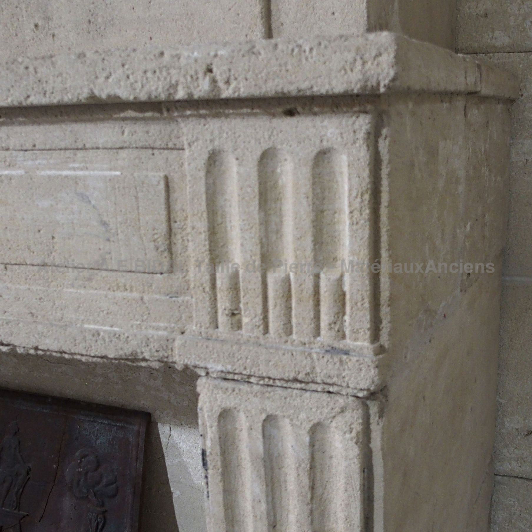 Antique Louis 16 fireplace ins tone - A fireplace with trumeau carved in natural stone.