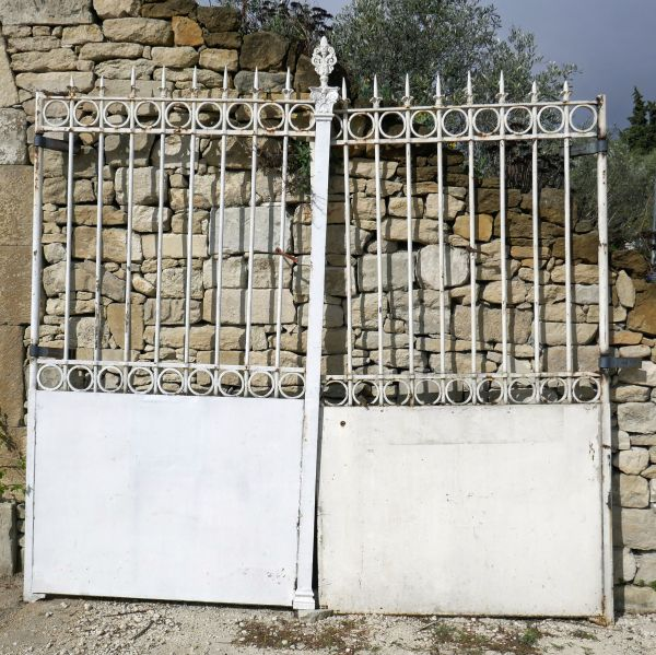 Antique gate - Beautiful old gate in riveted wrought iron colored in white.