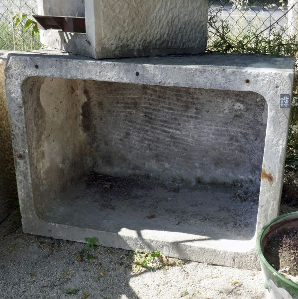 Large antique stone trough for sale at Alain Bidal Antique Materials in Provence.