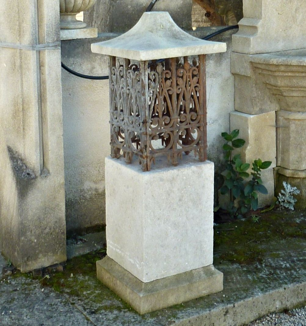 Luminaire made of wrought iron and limestone - old decoration.