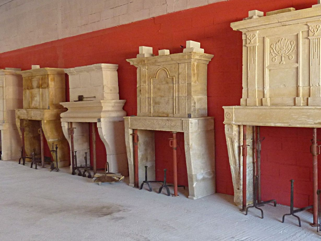Antique stone mantels with trumeau