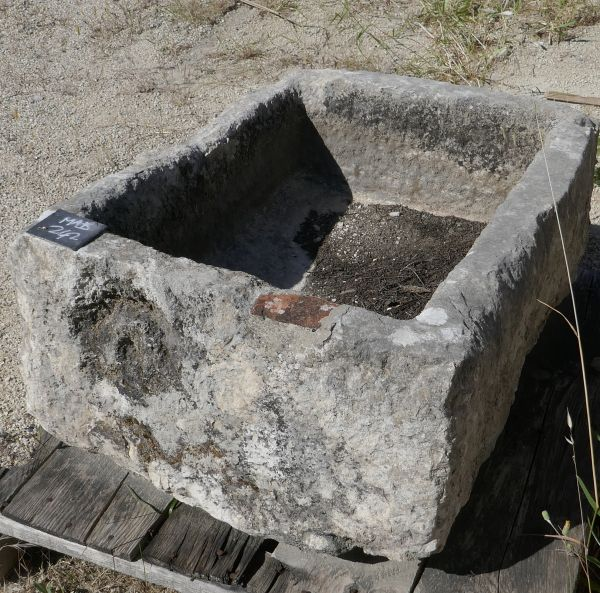Antique patinated white stone tough - small square shaped trough in stone.