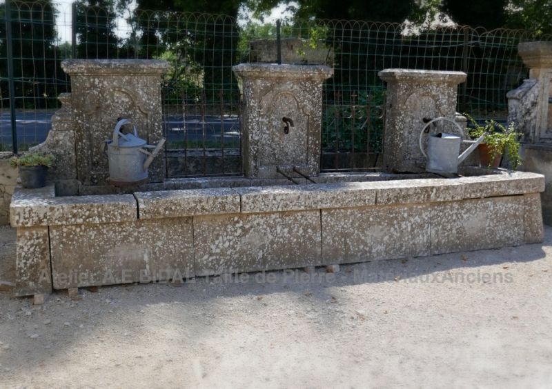 Large fountain of Provence in old stones and wrought iron | Antique garden fountain.