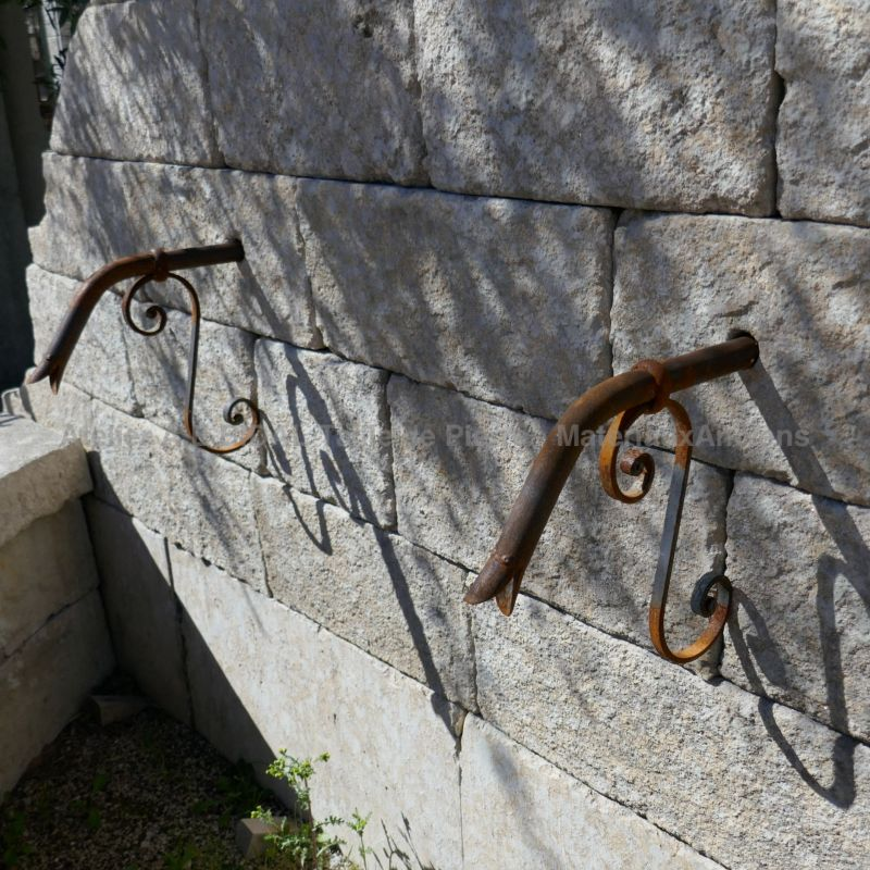 Details of the stone pediment and 2 wrought iron water spouts on our large wall fountain of Provence.