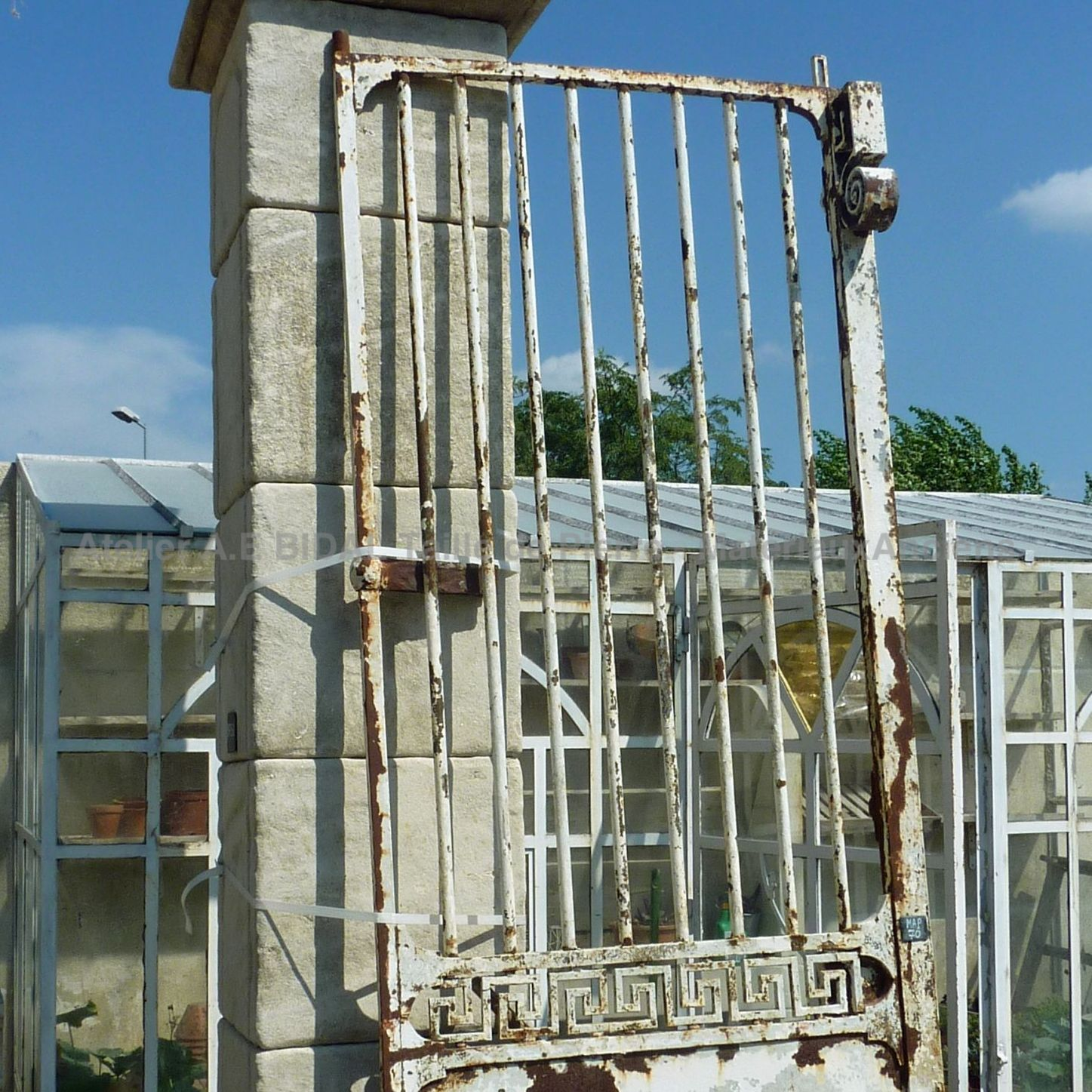Old wrought iron gate craftmade with beautiful hadnmade decorations.