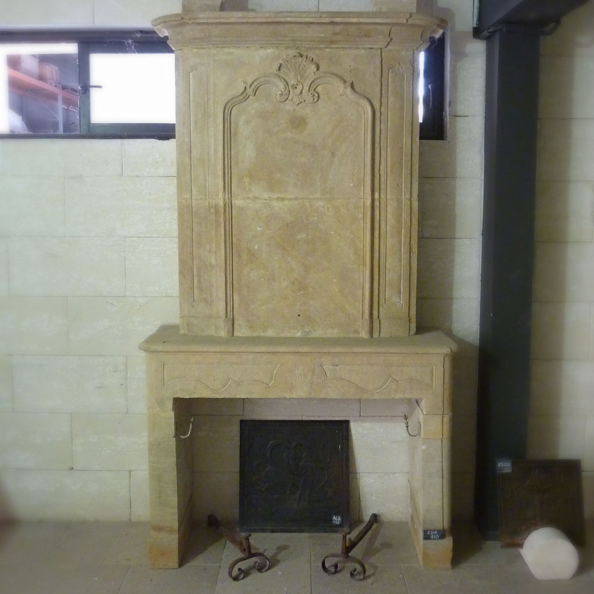18th century fireplace with overmantle- an old fireplace recovered in a French monastery.