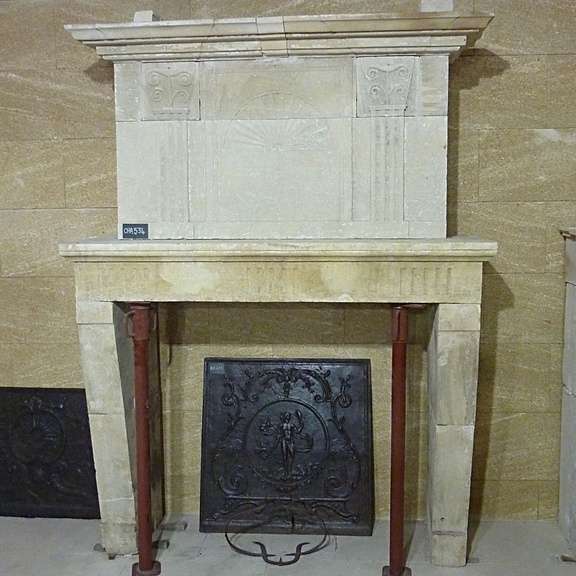 Antique Louis 16 fireplace in stone - Beautiful stone fireplace with sculpted hood.