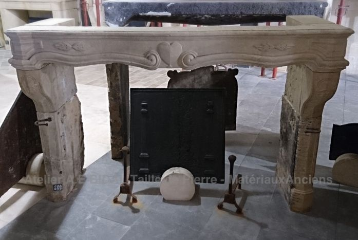 Antique fireplace in white stone finely carved - decorative fireplace.