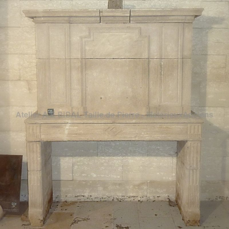 Antique Louis 16 stone fireplace - A fireplace with trumeau in stone.