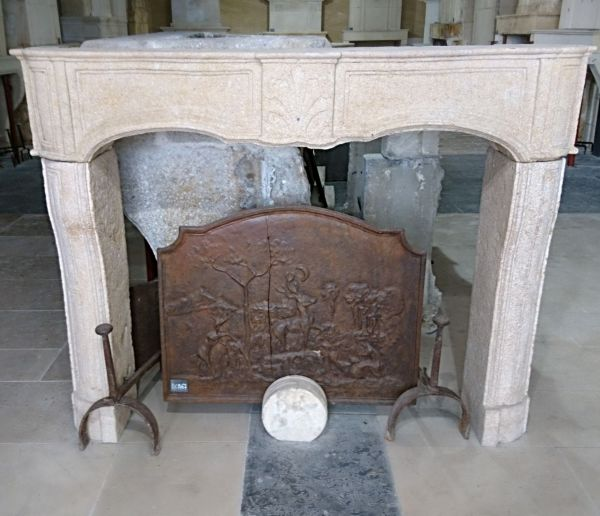 Louis 15 stone fireplace with a very neat look - an antique weathered stone fireplace.