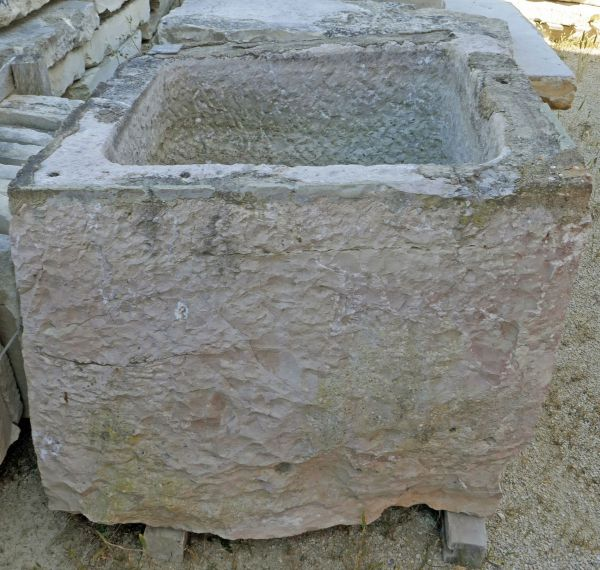 Antique trough in stone ideal for a rustic and robust planter on sale at Alain BIDAL Antique Materials in Provence.