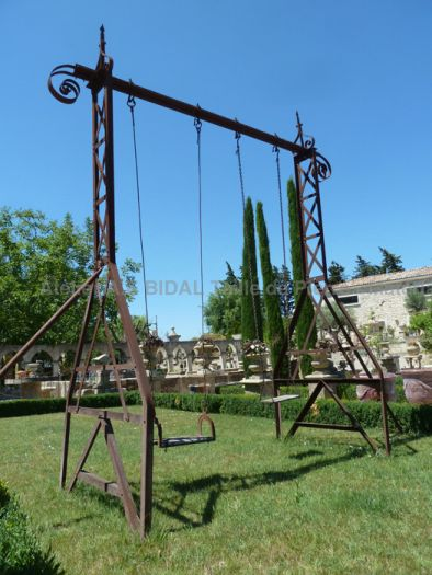 Wrought iron swing for garden / park - garden games made of old materials.
