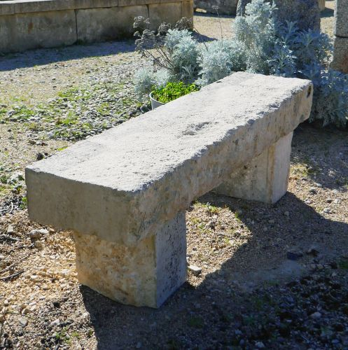 Small natural stone garden bench by the Antique Materials in Provence Alain Bidal