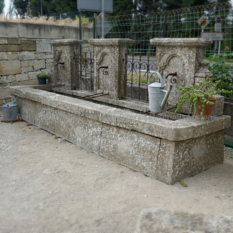 Antique garden fountain in stone and wrought iron for sale in Provence at Alain Bidal Antique Materials.
