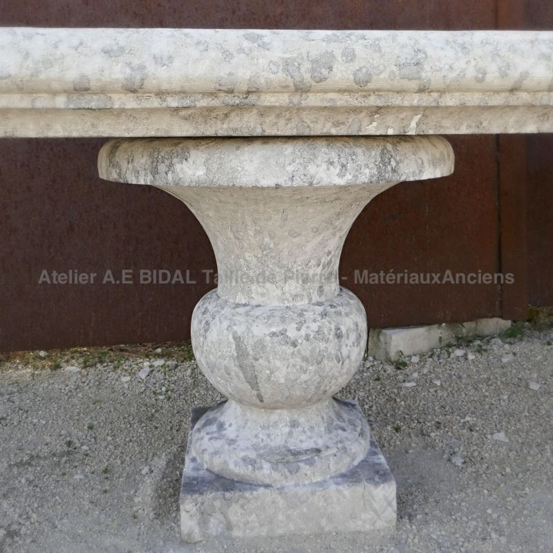 Detail of one of two limestone vases used as jambs on our garden bench in stone.