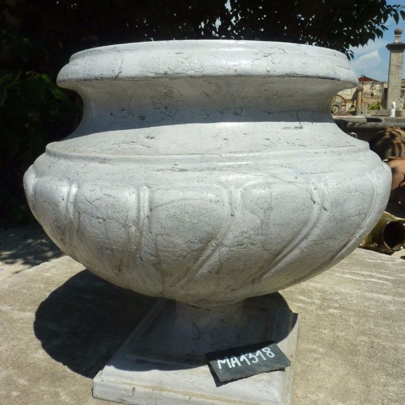 Beautiful old vase in classic style made of old grey cast iron  - decorative item made of old materials.
