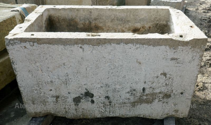 Antique trough in stone by Alain Bidal Antique Materials in Provence as an ecological and rustic planter.