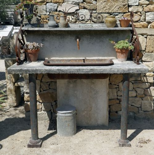 A stone sink and old materials for summer kitchen - stone sink made in Provence.