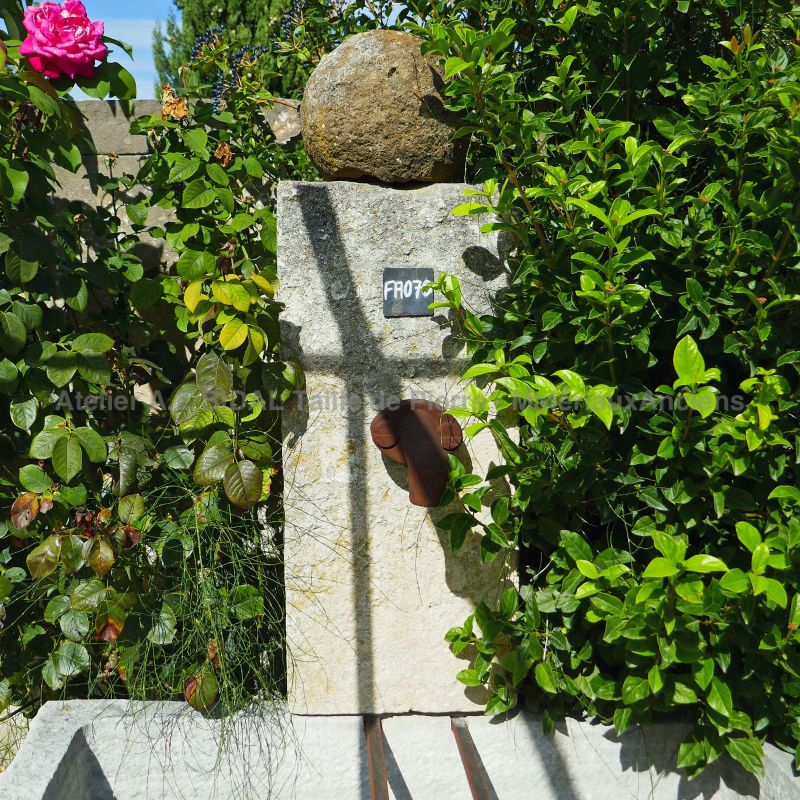 Picture of the stone pediment of our antique garden fountain in stone by Alain Bidal Antique Materials in Provence.