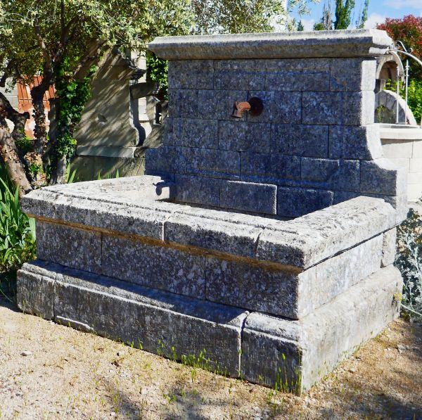 Garden wall fountain in old stone by Alain BIDAL Antique Materials in Provence
