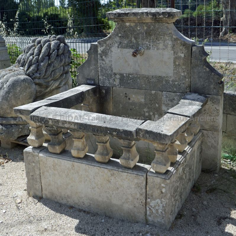 Old fountain with pediment allowing it to be made into a wall fountain in a park or garden.