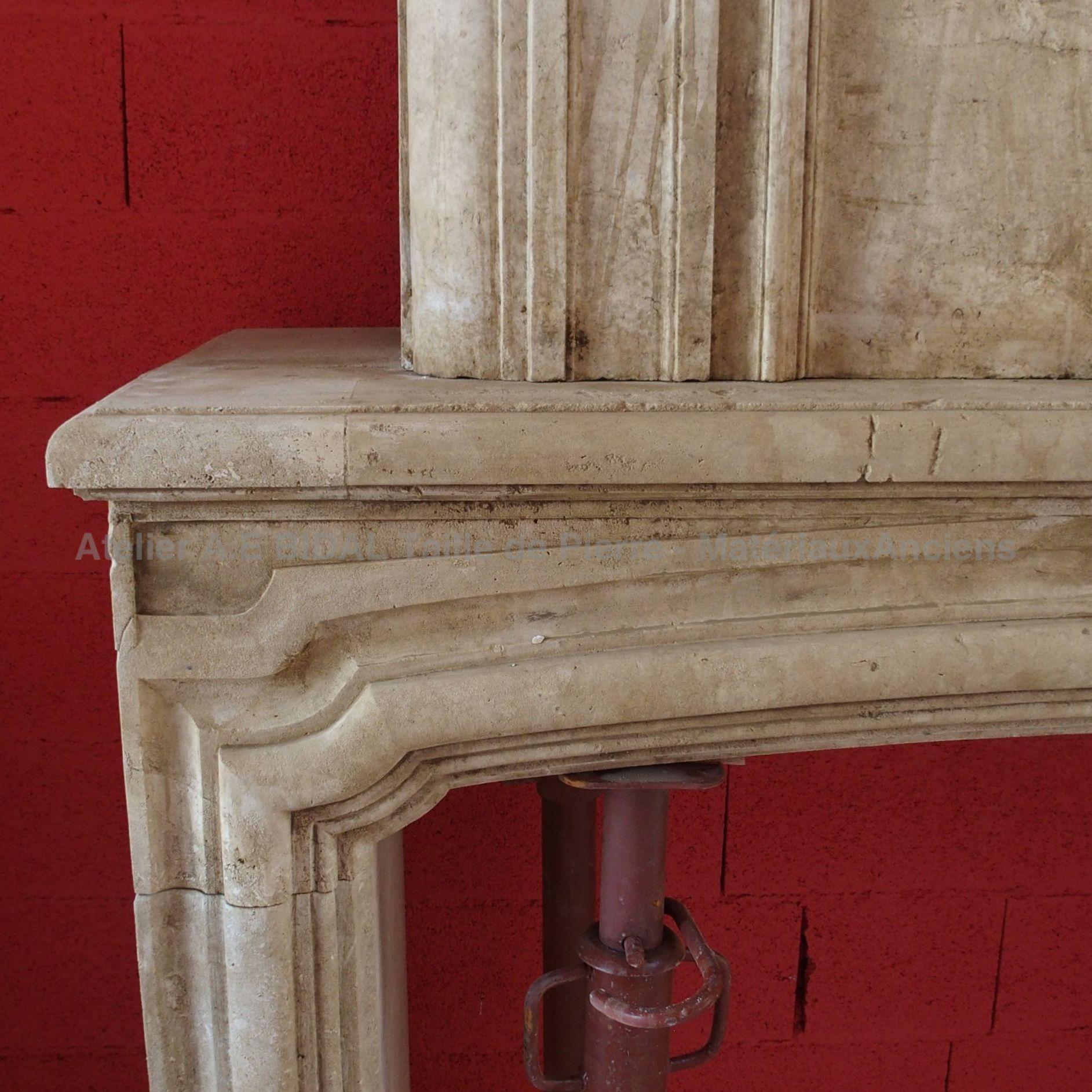 Fireplace with overmantle, a decorative fireplace made of old materials.